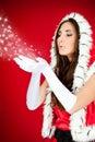 Santa woman blowing snow Royalty Free Stock Photo