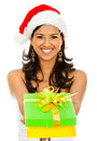 Santa woman giving a gift Royalty Free Stock Photo