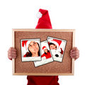 Santa woman holding christmas photos Stock Photography