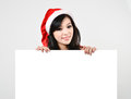 Santa woman  holding a white poster Royalty Free Stock Photography