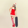 Santa woman posing with skateboard vintage Royalty Free Stock Photo