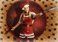 Santa woman spinning christmas music at club Royalty Free Stock Photo