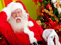 Santa worried about wish list Stock Photos