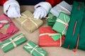 Santa Wrapping Christmas Presents Royalty Free Stock Photo