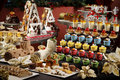 Santa's Kitchen Buffet with plenty of cake, muffin, candy and ch Royalty Free Stock Photo