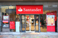 Santander group bank facade and cash machine the eurozone s largest and th largest company in the world Stock Image