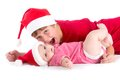 Santas christmas baby siblings wearing as santa Stock Photos