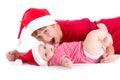 Santas christmas baby siblings wearing as santa Stock Photos