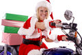Santas helper delivering gifts on motorcycle Royalty Free Stock Photo