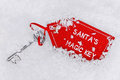 Santas magic key santa s dropped his in the snow Royalty Free Stock Image