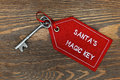 Santas magic key on a wooden background santa s rustic Stock Photos