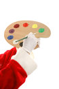 Santas paint palette santa s hands holding a and a paintbrush isolated design element Royalty Free Stock Photo