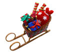 Santas sledges with gifts toy and red bag isolated Royalty Free Stock Photos