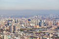 Santiago cityview from cerro san cristobal buldings can be seen in front of moutains and blue sky pollution is present too Royalty Free Stock Image