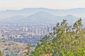 Santiago cityview from cerro san cristobal buldings can be seen in front of moutains and blue sky pollution is present too Stock Photography