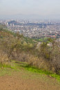 Santiago cityview from cerro san cristobal buldings can be seen in front of moutains and blue sky pollution is present too Royalty Free Stock Photography