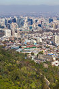 Santiago cityview from cerro san cristobal buldings can be seen in front of moutains and blue sky pollution is present too Royalty Free Stock Photo