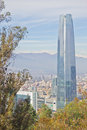 Santiago cityview from cerro san cristobal buldings can be seen in front of snowy moutains and blue sky Stock Photo