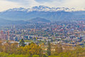 Santiago cityview from cerro san cristobal buldings can be seen in front of snowy moutains and blue sky Royalty Free Stock Image