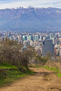 Santiago cityview from cerro san cristobal buldings can be seen in front of snowy moutains and blue sky Stock Photography