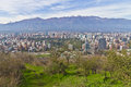 Santiago cityview from cerro san cristobal buldings can be seen in front of snowy moutains and blue sky Stock Photos