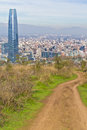 Santiago cityview from cerro san cristobal buldings can be seen in front of snowy moutains and blue sky Stock Image
