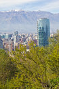 Santiago cityview from cerro san cristobal buldings can be seen in front of snowy moutains and blue sky pollution is present too Stock Photo