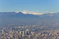Santiago cityview from cerro san cristobal buldings can be seen in front of snowy moutains and blue sky pollution is present too Royalty Free Stock Photos