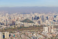 Santiago cityview from cerro san cristobal buldings and cerro santa lucia can be seen in front of moutains and blue sky pollution Stock Photo