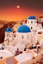 Santorini blue dome churches at sunset. Oia Village, Greece. Royalty Free Stock Photo
