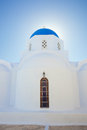 Santorini church with blue cupola pyrgos typical Stock Photo