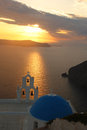 Santorini with church in fira greece typical against sunset Stock Photo