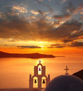 Santorini churches in fira greece amazing panorama with and sea view and colorful sunset Royalty Free Stock Photos