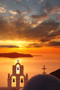 Santorini churches in fira greece amazing panorama with and sea view and colorful sunset Stock Images
