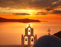 Santorini churches in fira greece amazing panorama with and sea view and colorful sunset Royalty Free Stock Photo