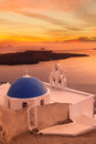 Santorini churches in fira greece amazing panorama with and sea view and colorful sunset Stock Photo