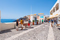 Santorini fira july tourists enjoy view on july in fira town on the santorini island greece is modern capital of greek aegean Royalty Free Stock Photos