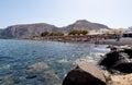 Santorini fira july tourists sunbathe on the kamari beach on july on the island of santorini thira greece is located eastern coast Stock Photography