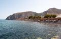 Santorini fira july tourists sunbathe on the kamari beach on july on the santorini thira greece island of is located eastern coast Stock Images