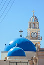 Santorini greece church towers in fira town Stock Images