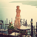 Santorini greece statue of aphrodite vintage style in outdoor cafe Stock Photos