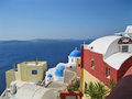 Santorini island greece a church with blue dome and houses scene Royalty Free Stock Photos