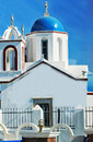 Santorini island greece a church with blue dome scene Stock Photos