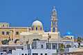 Santorini island greece a church with blue dome and white houses scene Royalty Free Stock Image