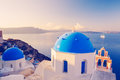 Santorini island greece white architecture and blue ocean sunrise Stock Photo
