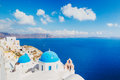 Santorini island greece white architecture and blue ocean view of caldera with domes Royalty Free Stock Photo