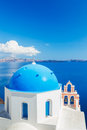 Santorini island greece white architecture and blue ocean view of caldera with domes Stock Photos