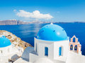 Santorini island greece white architecture and blue ocean view of caldera with domes Royalty Free Stock Image