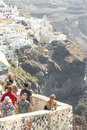 Santorini island rock tourists go sightseeing in santori on a background the city of fira Stock Photos