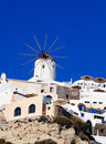 Santorini oia village windmill in on island greece Stock Photos